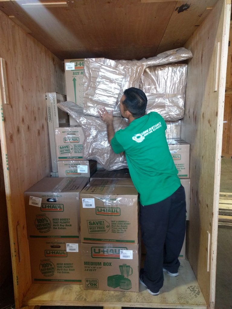 Unloading Boxes - Long Distance Moving Experts